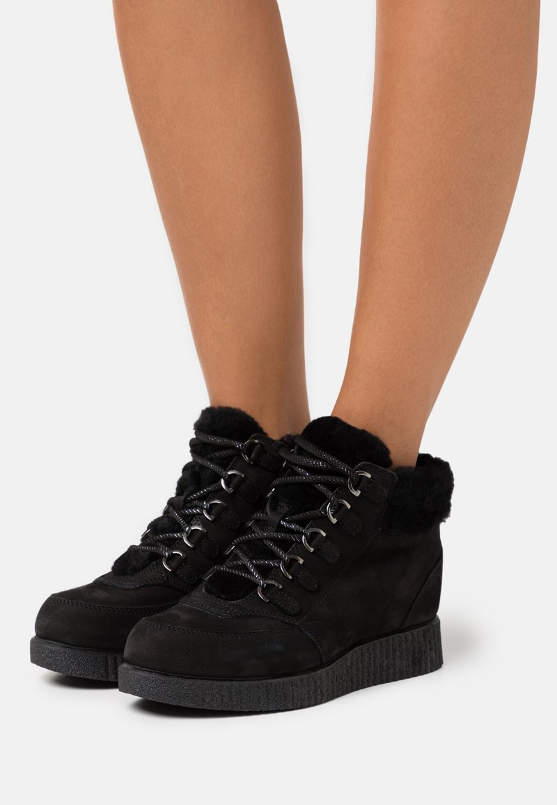 Unisa - CARRY - Lace-up ankle boots - black