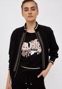 Liu Jo Jeans - Print T-shirt - black - 0