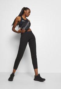 Champion - BRA LEGACY - Sports bra - dark blue - 1
