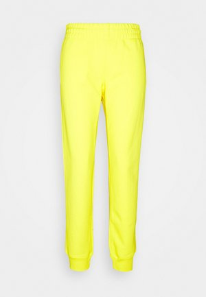 TROUSERS - Tracksuit bottoms - yellow