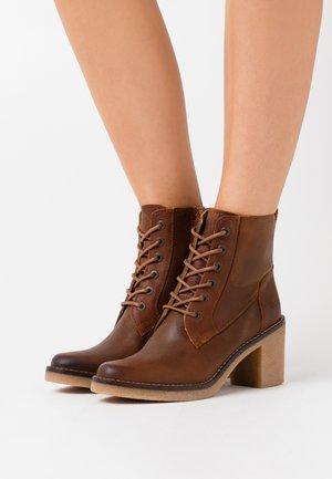 AVERNE - Lace-up ankle boots - light orange