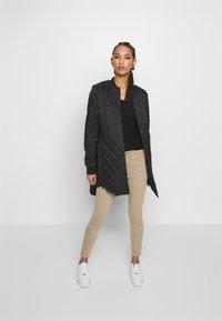 Vero Moda - VMHAYLE JACKET - Short coat - black - 1