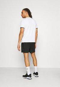 Puma - PERFORMANCE SHORT  - Sports shorts - black - 2