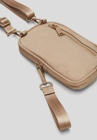 s.Oliver - Across body bag - beige - 6
