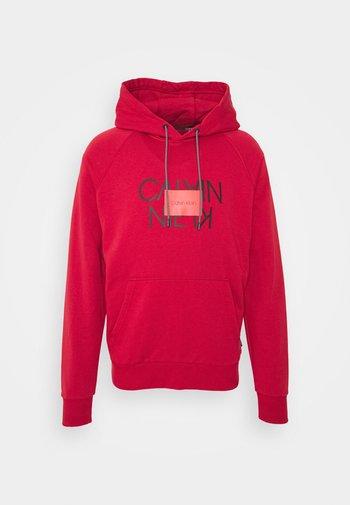 TEXT REVERSED HOODIE - Sweatshirt - red