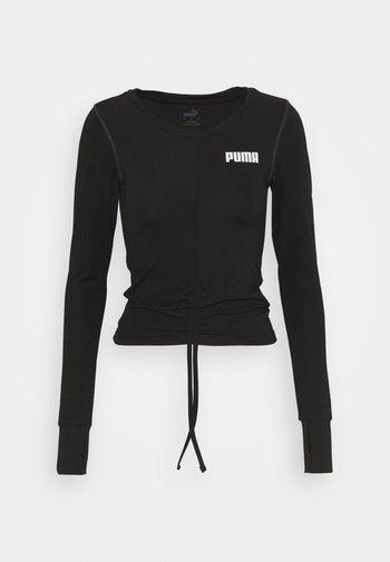PAMELA REIF X PUMA COLLECTION RUSHING - Funkční triko - puma black