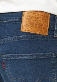 Levi's® - 512 SLIM TAPER  - Jeans Tapered Fit - blue denim - 4