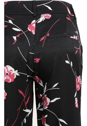 DENA GEMUSTERT - Trousers - black alix