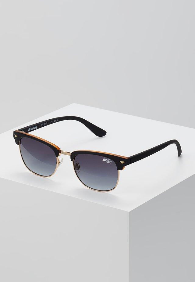 LEO - Zonnebril - black/amber