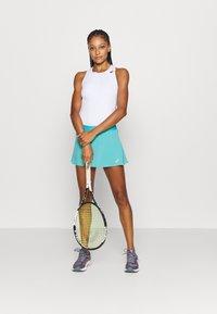 ASICS - TENNIS PLEATS SKORT - Sports skirt - techno cyan - 1