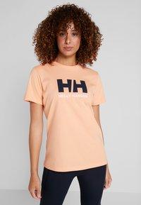 Helly Hansen - LOGO - T-shirts print - melon - 0