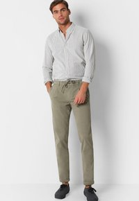 Scalpers - Trousers - taupe - 1