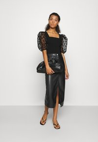 River Island - DOTTED ORGANZA SLEEVE BLOUSE - Camicetta - black - 1