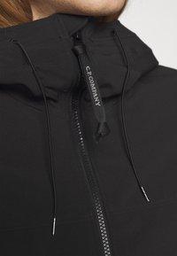 C.P. Company - OUTERWEAR  SHORT JACKET - Lehká bunda - black - 6