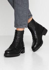 Bullboxer - Platform ankle boots - black - 0