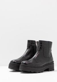 Janet Sport - Kotníkové boty na platformě - miranda nero - 4