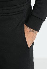 Lacoste Sport - MEN TENNIS SHORT - Sports shorts - black - 3