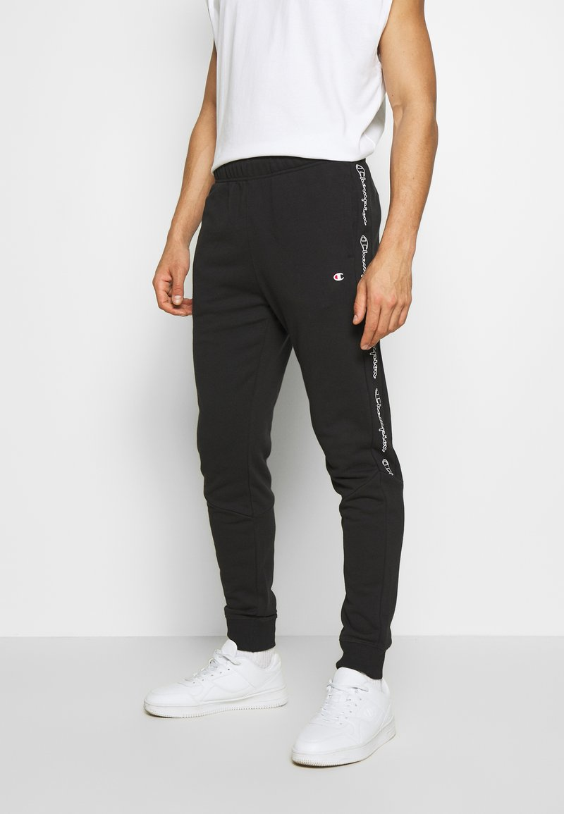 Champion - TAPE PANTS - Pantalon de survêtement - black