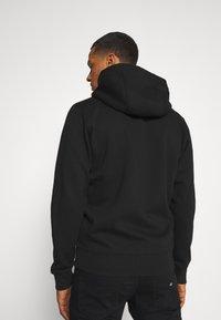 Tommy Jeans - REGULAR ZIP HOOD - Vetoketjullinen college - black - 2