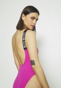 Calvin Klein Swimwear - INTENSE POWER SCOOP BACK ONE PIECE - Costume da bagno - stunning orchid - 3