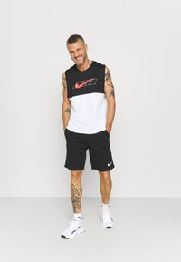 Nike Performance - TANK DRY ENERGY - Sports shirt - white/bright crimson - 1
