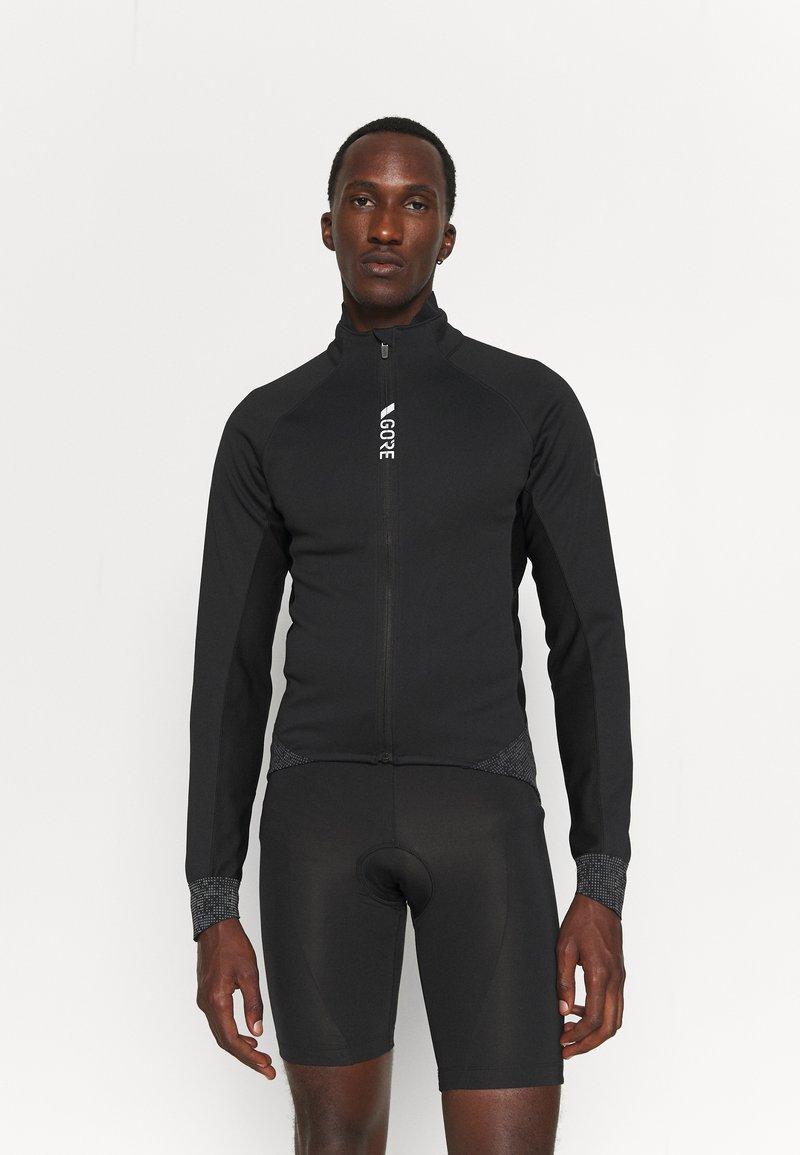 Gore Wear - INFINIUM™ THERMO JACKET - Soft shell jacket - black