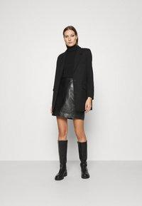 JUST FEMALE - MOON SKIRT - A-line skirt - black - 1
