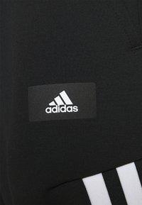 adidas Performance - 3-STRIPES O-PANT FUTURE ICONS - Tracksuit bottoms - black - 4