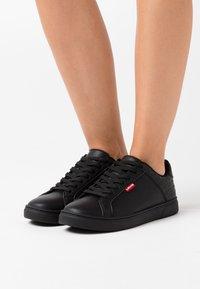 Levi's® - CAPLES - Trainers - regular black - 0