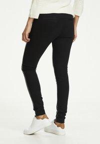 Kaffe - Leather trousers - black deep / gold - 1