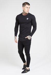 SIKSILK - Spodnie materiałowe - black - 1
