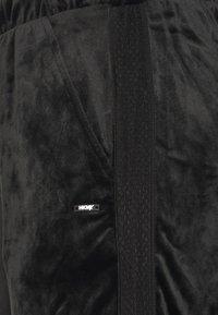 Hunkemöller - CUFFED PANTS - Tracksuit bottoms - black - 5