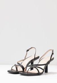 RAID Wide Fit - WIDE FIT ANINA - T-bar sandals - black - 4