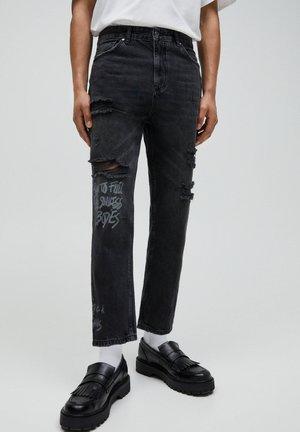MIT ZIERRISSEN  - Relaxed fit jeans - black