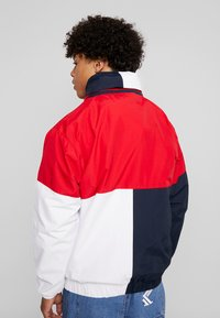 Karl Kani - RETRO BLOCK WINDBREAKER - Summer jacket - red/black/white - 3