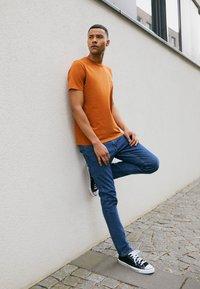 Lee - LUKE - Jeans slim fit - mid stone wash - 1