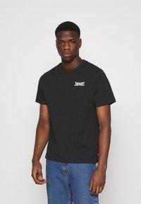 Levi's® - TEE UNISEX - Print T-shirt - caviar - 0