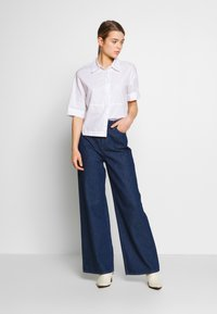 Lee - STELLA A LINE - Flared Jeans - rinse - 1