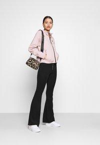 Nike Sportswear - Zip-up sweatshirt - champagne/black - 1