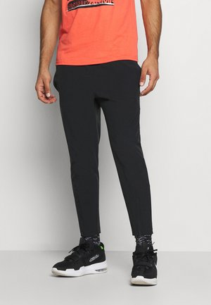 CURRY WARMUP - Pantalon de survêtement - black