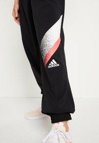 adidas Performance - Tracksuit bottoms - black/white/white - 5
