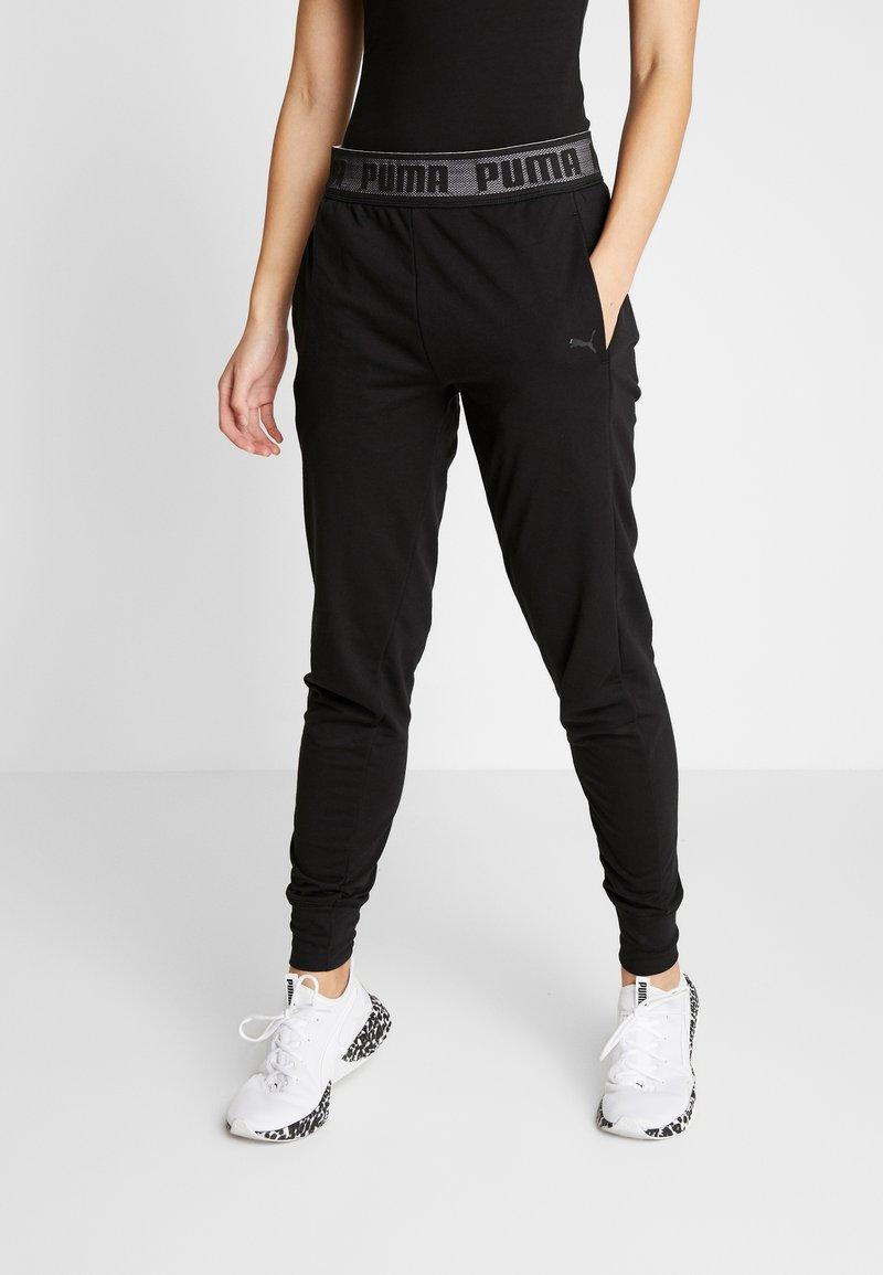 Puma - LOGO PANT - Teplákové kalhoty - black