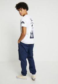 Carhartt WIP - JOGGER COLUMBIA - Cargo trousers - blue rinsed - 2
