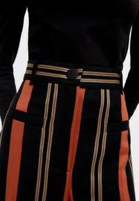 Uterqüe - Trousers - black - 5