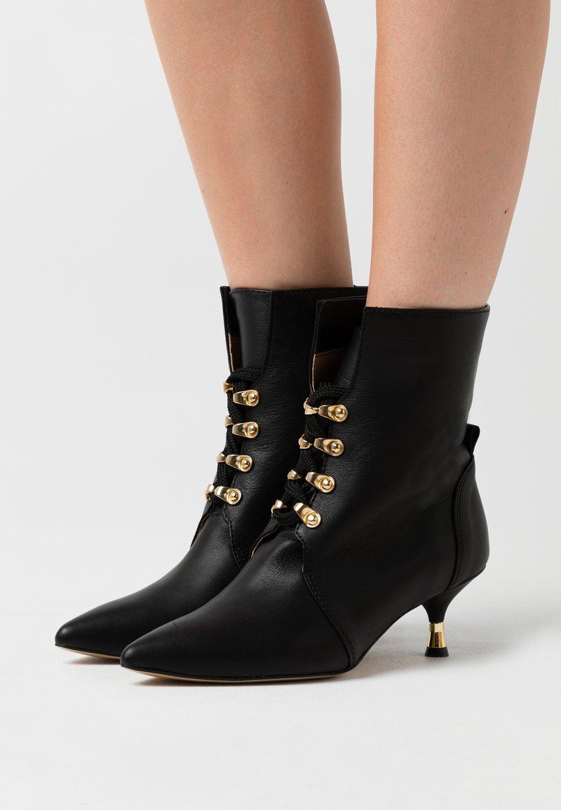 L37 - BULLETPROOF PLUS - Lace-up ankle boots - black
