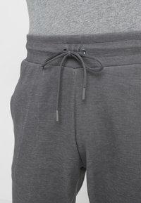 Nike Sportswear - OPTIC - Tracksuit bottoms - dark grey/heather - 3