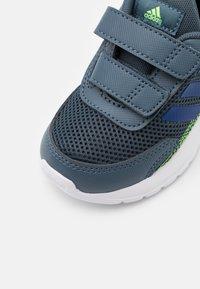 adidas Performance - TENSAUR RUN UNISEX - Neutral running shoes - legacy blue/team royal blue/signal green - 5