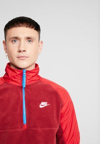 Nike Sportswear - WINTER - Fleece trui - team red/gym red/lt photo blue/white - 3