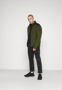 Calvin Klein - QUILTED JACKET - Light jacket - green - 1