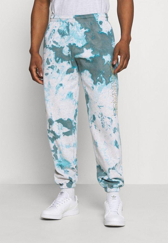 TRACK LEGACY TIE DYE - Teplákové kalhoty - blue
